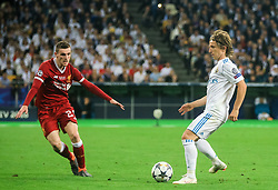 Andy Robertson of Liverpool vs Luka Modric of Real Madrid during the UEFA Champions League final football match between Liverpool and Real Madrid at the Olympic Stadium in Kiev, Ukraine on May 26, 2018.Photo by Sandi Fiser / Sportida