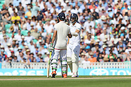 Mark Wood and Moeen Ali of England during the third day of the 5th Investec Ashes Test match between England and Australia at The Oval, London, United Kingdom on 22 August 2015. Photo by Ellie Hoad.