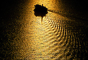 Cruise Ship at sunset in glow on water, aerial
