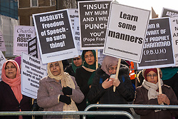 """London, February 8th 2015. Muslims demonstrate outside Downing Street  """"to denounce the uncivilised expressionists reprinting of the cartoon image of the Holy Prophet Muhammad"""". PICTURED: Women protest separately from men as demanded by Islamic tradition."""