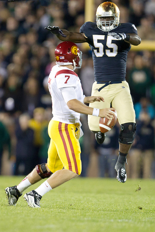 Notre Dame inside linebacker Prince Shembo (#55) rushes USC quarterback Matt Barkley (#7) during first quarter of NCAA football game between Notre Dame and USC.  The USC Trojans defeated the Notre Dame Fighting Irish 31-17 in game at Notre Dame Stadium in South Bend, Indiana.