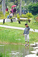 Central Park in Kaohsuing, Taiwan is a perfect place to relax.  This boy is fishing in one of the many ponds.