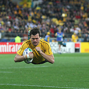 Adam Ashley-Cooper, Australia, dives over for another Australian during the Australia V USA, Pool C match during the IRB Rugby World Cup tournament. Wellington Stadium, Wellington, New Zealand, 23rd September 2011. Photo Tim Clayton...