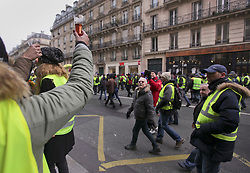19 January 2019. Paris, France.<br /> Gilets Jaunes - Acte X take to the streets of Paris. Supporters raise a toast. An estimated 7,000 people took part in the looping 14 km route from Place des Invalides to protest tax hikes from the Government of Emmanuel Macron imposed on the people. An estimated 80,000 people took part in protests across the country. Regrettably the movement has attracted a violent element of agitators who often face off with riot police at the end of the marches which tends to deflect attention away from the message of the vast majority of peaceful protesters.<br /> Photo©; Charlie Varley/varleypix.com