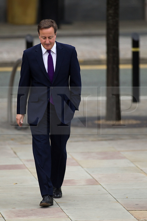 © Licensed to London News Pictures. 05/10/2011. Manchester, UK. David Cameron arrives at the Conservative Party Conference on the morning of 5th August 2011. Photo credit : Joel Goodman/LNP