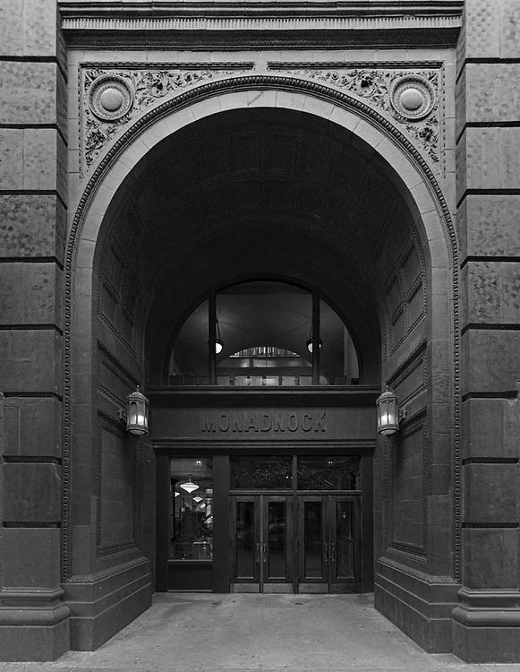 Monadnock building, Holabird and Roche, 1893, south, evtrance.  Digital photography. Exterior Architectural Photography. Buildings, locations, architecture. Chicago, Illinois, built landscape,
