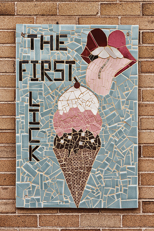 I found this mosaic in the alley behind Bonnie Brae Ice Cream shop in the Bonnie Brae district of Denver, Colorado. I love the play on the Rolling Stones lips and the detailed tile work.