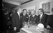 22/03/1966<br /> 03/22/1966<br /> 22 March 1966<br /> Northern Ireland tourist Board Exhibition at the Little Theatre, Brown Thomas in Dublin. Picture shows Mr Brian Faulkner (second from right), Northern Ireland Minister of Commerce, chatting with (l-r), Dr J.J. O'Driscoll, Director General, Bord Failte; Mr Brendan O'Regan, Chairman of Bord Failte and Alderman Eugene Timmons, Lord Mayor of Dublin after the official opening.