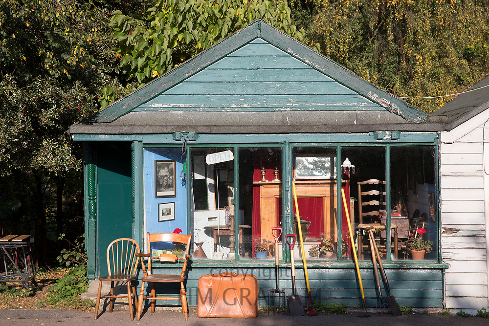 Bric a brac and antique furniture at quaint retro antiques shop at Yoxford, Saxmundham in Suffolk, England, UK