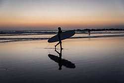 Ardalan Afshar heads back in after catching some waves  in Venice Beach, California October 9, 2014. (Photo by Ami Vitale)