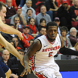 Rutgers Scarlet Knights guard Eli Carter (5) drives to the basket against Notre Dame Fighting Irish guard/forward Pat Connaughton (24) during Big East NCAA action during Rutgers' 65-58 victory over Notre Dame at the Louis Brown Athletic Center in Piscataway, N.J.