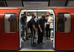 © Licensed to London News Pictures. 19/07/2021. London, UK. Passengers board a Victoria line Underground train at Euston Station on the morning of Freedom Day. All covid regulations in England are being scrapped from today even though infections and hospitalisations are on the increase. Photo credit: Peter Macdiarmid/LNP