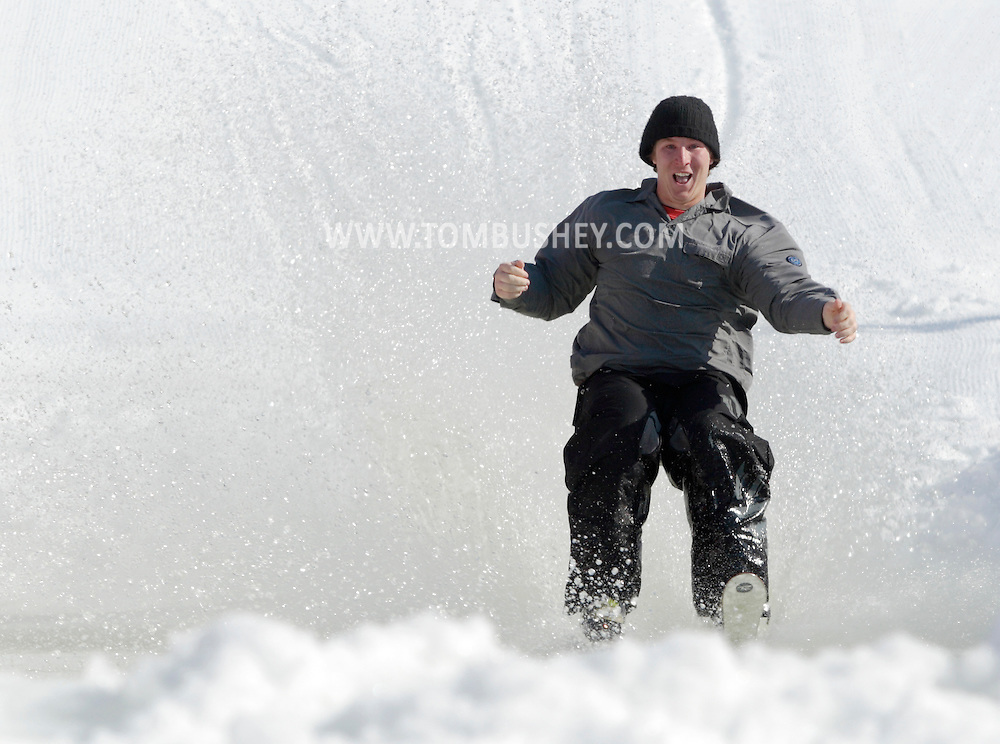 Warwick, New York - A skier crosses the water during the annual Spring Rally at Mount Peter Ski and Ride on March 21, 2010.