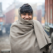 Driver cover with blanket during the winter in traffic jam.
