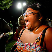 A woman reacts to the not guilty verdict in the George Zimmerman murder trial at the Seminole County Courthouse on Saturday, July 13, 2013, in Sanford, Florida.  Zimmerman had been charged for the 2012 shooting death of Trayvon Martin and was found not guilty by a jury of six women. The protests on the grounds ended peacefully after the verdict was read. (AP Photo/Alex Menendez)