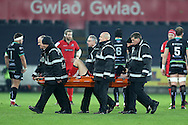 Chris Dean of Edinburgh Rugby is stretchered off with an injury early in the game. Guinness Pro12 rugby match, Ospreys v Edinburgh Rugby at the Liberty Stadium in Swansea, South Wales on Friday 2nd December 2016.<br /> pic by Andrew Orchard, Andrew Orchard sports photography.