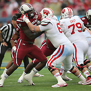 South Carolina Gamecocks defensive end Jadeveon Clowney (7) plays against Wisconsin Badgers offensive linesman Tyler Marz (61) during the NCAA Capital One Bowl football game between the South Carolina Gamecocks who represent the SEC and the Wisconsin Badgers who represent the Big 10 Conference, at the Florida Citrus Bowl on Wednesday, January 1, 2014 in Orlando, Florida. (AP Photo/Alex Menendez)