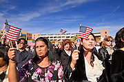 14 JANUARY 2012 - CHANDLER, AZ:    New US citizens wave the American flag after taking the oath of citizenship after a naturalization ceremony in Chandler, AZ, Jan. 14. More than 140 people from 21 countries were naturalized as United States citizens Saturday in Chandler. This is the third year Chandler has sponsored a naturalization ceremony in connection with the Dr. Martin Luther King holiday.  PHOTO BY JACK KURTZ