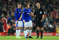 5th January 2018 - FA Cup - 3rd Round - Liverpool v Everton - Wayne Rooney of Everton (C) and James McCarthy of Everton (L) speak to referee Robert Madeley at half-time - Photo: Simon Stacpoole / Offside.