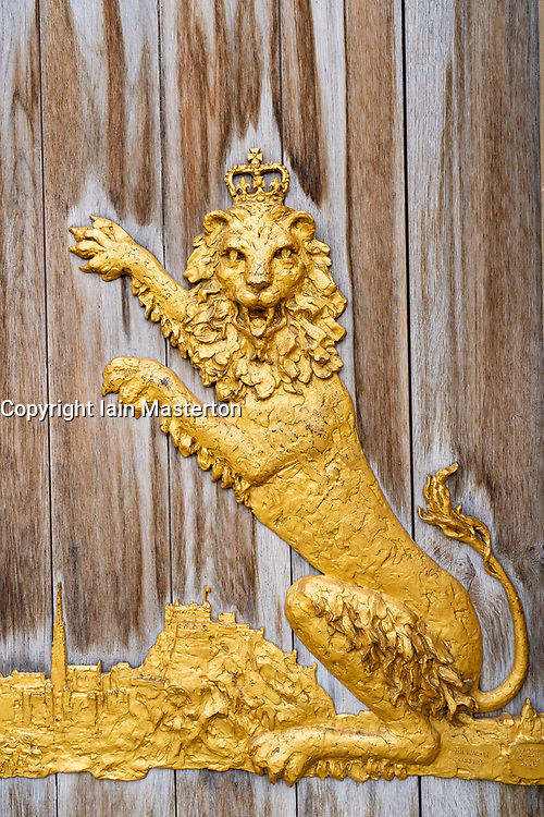 Ornate gilded decoration on wooden entrance doors at Queen's Gallery at Palace of Holyroodhouse, Edinburgh, Scotland, UK