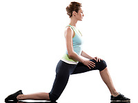 one caucasian woman Workout Posture fitness exercise kneeling stretching legs on studio white background