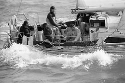 The Duke of Edinburgh (l) sails the choppy sea aboard his Yeoman XIX, in class one, of Cowes Regatta.