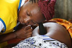 Violet Nyamwanya checks a womens pregnancy progression at an ANC outreach clinic. SAHFA baseline survey visit to Angiya, Homa Bay County, Kenya.  SAHFA Kenya © April 2019