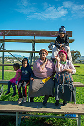 """Friends (L to R) Anelda Williams, 49, and Dora Alexander, 59, (right) with their children Marlin and grandchildren, in Jamestown, Stellenbosch, on Tuesday, June 16, 2020. <br /> """"I was a house keeper for three days,"""" says Alexender. """"There is no job now because of lockdown. Because there is children in the house (where I was working)."""" <br /> """"I'm waiting for the R350. SASSA (South African Social Security Agency) promised when you sit at home, when there is no work because of lockdown, for six months, you get the R350,"""" she says. <br /> """"I'm still waiting for that. I sent my son to the bank. There is nothing in the bank,"""" she says. """"I applied for it about three weeks ago. I think I must wait and see until the end of the month."""" PHOTO: EVA-LOTTA JANSSON"""