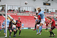 Manchester City midfielder Sam Mewis (22)  heads from the corner  during the FA Women's Super League match between Manchester United Women and Manchester City Women at Leigh Sports Village, Leigh, United Kingdom on 14 November 2020.
