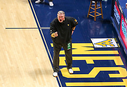 Jan 25, 2021; Morgantown, West Virginia, USA; West Virginia Mountaineers head coach Bob Huggins yells from the bench during the second half against the Texas Tech Red Raiders at WVU Coliseum. Mandatory Credit: Ben Queen-USA TODAY Sports