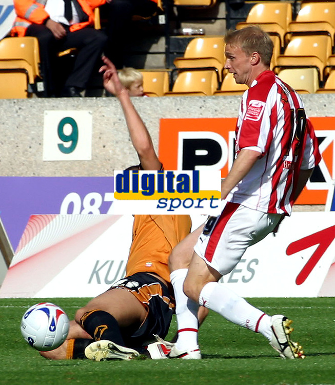 Photo: Dave Linney.<br />Wolverhampton Wanderers v Stoke City. Coca Cola Championship. 23/09/2006Wolves's.Charlie Mulgrew(L) gets in a challenge on Luke Chadwick