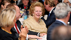 Leader of the Conservative Party David Cameron  presents  a bust of Winston Churchill  to Baroness Thatcher for  The Churchill Centre award for Statesmanship  in Central London ,Tuesday  October 20 , 2009 .Photo By Andrew Parsons ...