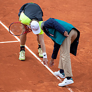 PARIS, FRANCE October 01. Denis Shapovalov of Canada argues a line call with chair umpire Carlos Ramos while serving for the match during his match against Roberto Carballes Baena of Spain in the second round of the singles competition on CourtSuzanne Lenglen during the French Open Tennis Tournament at Roland Garros on October 1st 2020 in Paris, France. (Photo by Tim Clayton/Corbis via Getty Images)