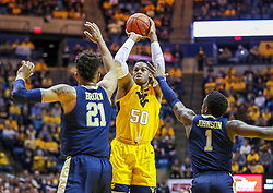 Dec 8, 2018; Morgantown, WV, USA; West Virginia Mountaineers forward Sagaba Konate (50) shoots a jumper during the second half against the Pittsburgh Panthers at WVU Coliseum. Mandatory Credit: Ben Queen-USA TODAY Sports