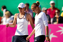 Katarina Srebotnik and Polona Hercog of Slovenia during doubles against Rebecca Marino and Sharon Fichman of Canada at the second day of the tennis Fed Cup match between Slovenia and Canada at Bonifika, on April 17, 2011 in Koper, Slovenia.  (Photo by Vid Ponikvar / Sportida)