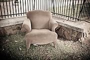 A lone chair left along the sidewalk in downtown Honolulu, Hawaii. Missoula Photographer