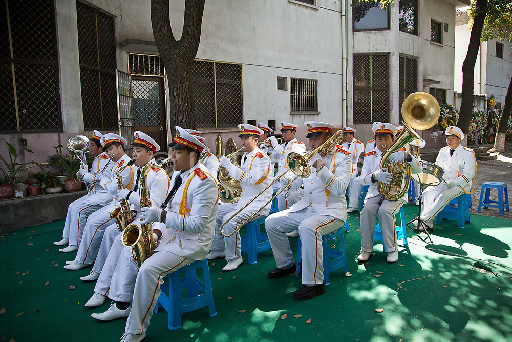 A brass band plays outside of a house where the body of late village party chief Wu Renbao lays at Huaxi, Jiangsu Province, China on 22 March  2012.  Wu is a outlier among local political leaders as his village is one of the wealthiest in China while remaining a collective, building up a personality cult that is much larger than his official title reflects.