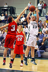 10 January 2009: Kylie Castans pulls up next to the paint for a shot as Dani Ripkey moves in for a possible block.The Illinois Wesleyan Titans, ranked #1 in the latest USA Today/ESPN poll, take down the Lady Reds of Carthage and remain undefeated,  2-0 in the CCIW and over all to 12-0. This is the first time in the history of the Lady Titans Basketball they have been ranked #1 The Titans and Lady Reds played in the Shirk Center on the Illinois Wesleyan Campus in Bloomington Illinois.