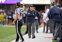 Sep 8, 2018; Morgantown, WV, USA; West Virginia Mountaineers head coach Dana Holgorsen walks the sidelines during the first quarter against the Youngstown State Penguins at Mountaineer Field at Milan Puskar Stadium. Mandatory Credit: Ben Queen-USA TODAY Sports