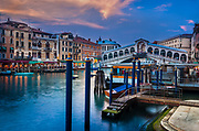 "Venice's Canal Grande at dusk<br /> .....<br /> Venice is a city in northeastern Italy sited on a group of 118 small islands separated by canals and linked by bridges. It is located in the marshy Venetian Lagoon which stretches along the shoreline, between the mouths of the Po and the Piave Rivers. Venice is renowned for the beauty of its setting, its architecture and its artworks. The city in its entirety is listed as a World Heritage Site, along with its lagoon. Venice is the capital of the Veneto region. In 2009, there were 270,098 people residing in Venice's comune. Although there are no historical records that deal directly with the founding of Venice, tradition and the available evidence have led several historians to agree that the original population of Venice consisted of refugees from Roman cities near Venice such as Padua, Aquileia, Treviso, Altino and Concordia (modern Portogruaro) and from the undefended countryside, who were fleeing successive waves of Germanic and Hun invasions. Some late Roman sources reveal the existence of fishermen on the islands in the original marshy lagoons. They were referred to as incolae lacunae (""lagoon dwellers""). The traditional founding is identified with the dedication of the first church, that of San Giacomo at the islet of Rialto (Rivoalto, ""High Shore""), which is said to have been at the stroke of noon on 25 March 421."
