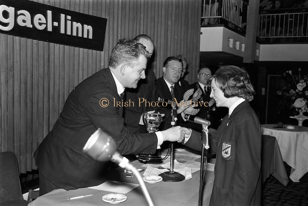 25/04/1964<br /> 04/25/1964<br /> 25 April 1964<br /> Gael Linn Secondary Schools Debating Competition final at the Shelbourne Hotel, Dublin. Annraoi O Braonain, (stiúrthóir Gael Linn) presenting the Gael Linn trophy to the winner of the Individual Speaker Section, Aine Nic Oda, Clochar na Trocaire, Carrick on Suir, Co. Tipperary. Also visible in the image is Mr Charles Haughey, Minister for Justice.
