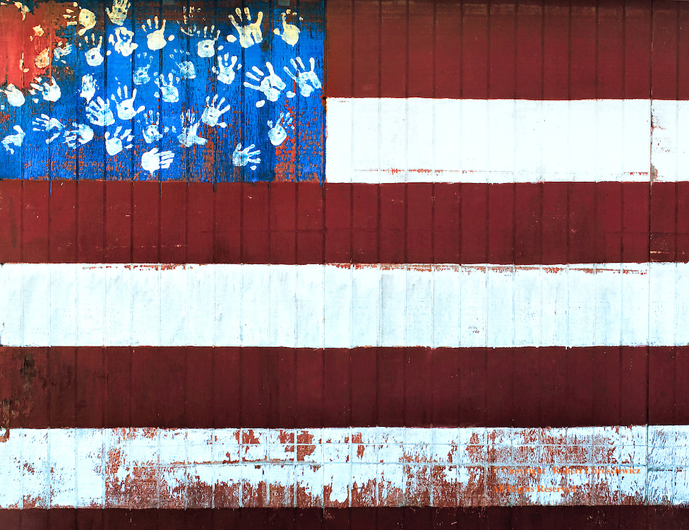 Faded Dream: This artistic representation of a weathered American flag was found on a work shed; using children's hand prints for stars, it can be viewed as a visual metaphor; of the worn aspirations and dreams of a country past and for the youth of tomorrow, in Aberdeen Washington, United States of America.