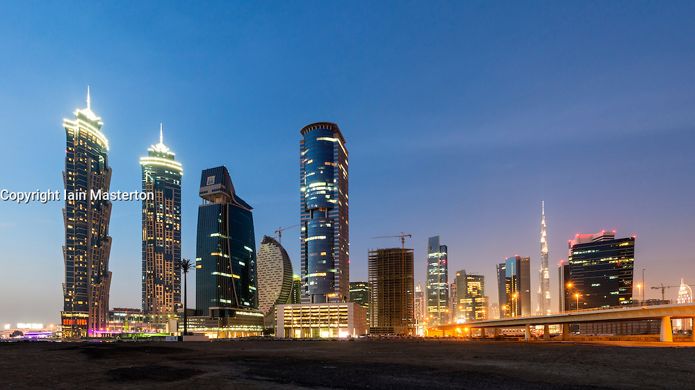 Futuristic skyline at night of new skyscrapers at Business Bay in Dubai United Arab Emirates