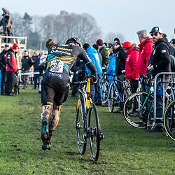 2019-12-27 Cycling: dvv verzekeringen trofee: Loenhout: Corne van Kessel having a quick bike change