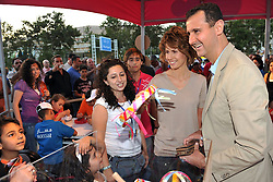 File photo - Syria's President Bashar Al Assad and First Lady Asma has told british TV Sky News they would welcome the Obamas to Damascus to push forward peace process. That was during posing first stone of an educational project in Damascus, Syria on July 2, 2009. Al Assad's comments are the latest in a series of signs that US-Syrian relations are improving after years of tension. Syria's British-born first lady Asma Assad has begun treatment for breast cancer. The Syrian presidency posted on its Facebook page a photo of President Bashar Assad sitting next to his wife in a hospital room. Photo by Balkis Press/ABACAPRESS.COM