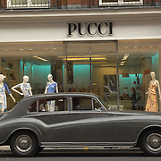 Vintage car parked in front of Pucci shop, Sloane Street, London
