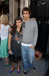 LOLA HOBBS and ALEX DELLAL at an exhibition of photographs by David Montgomery entitled 'Shutterbug' held at Scream, 34 Bruton Street, London W1 on 13th July 2006.<br />
