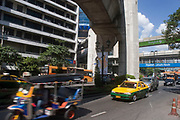 Traffic moves below the BTS skytrain in Pratunam, Bangkok. Despite the sometimes heavy traffic, the sky remains clear and blue.