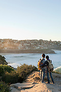 Couple looking over Bronte Beach in Sydney, New South Wales, Australia