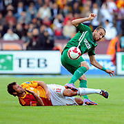 Galatasaray's Lucas NEILL (L) and Bursaspor's Sercan YILDIRIM (R) during their Turkish Super League soccer match Galatasaray between Bursaspor at the AliSamiYen Stadium at Mecidiyekoy in Istanbul Turkey on Sunday 25 April 2010. Photo by TURKPIX